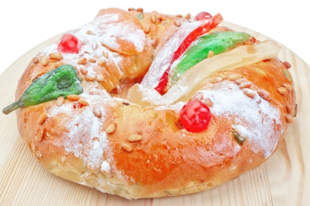 Portuguese king cake on a wooden stand  On a white background  Close-up  Archivio Fotografico