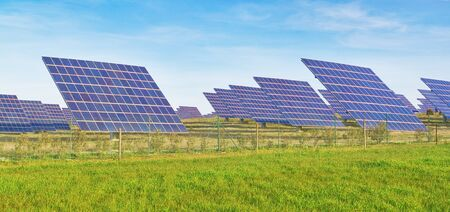 silicium: Solar battery panel on the green meadow  Editorial
