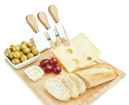Set for cutting cheese and snacks for wine  On a white background  photo
