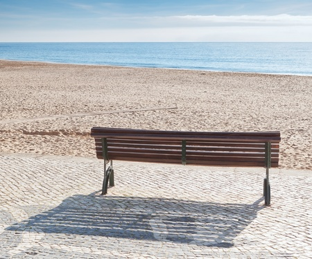 Bench on the beach of the sea. Concept. photo