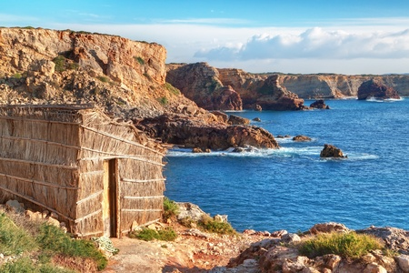 fishing cabin: Old fishing hut lodge on the beach. Portugal, Sagres. Stock Photo
