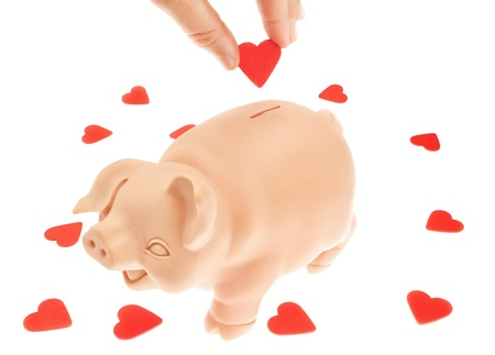 Cute piglet-piggy bank for the collection of hearts  Valentine photo