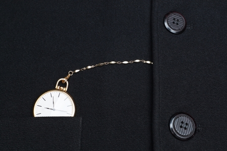 Pocket watch on a chain hidden in the jacket businessman  photo