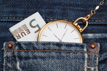Pocket watch with chain in jeans and five euros  Close-up  photo