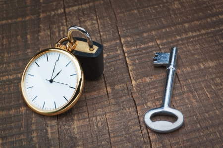 Padlock store time and the key controls  The concept time management  photo