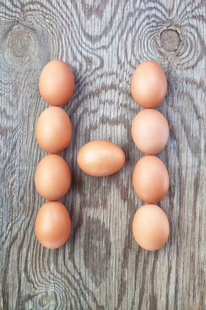 A letter h from the eggs for easter  On a wooden texture  photo
