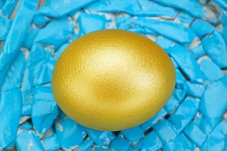 Golden easter egg on blue background. photo