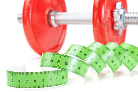 Green measuring meter and dumbbells for fitness  On a white background  photo