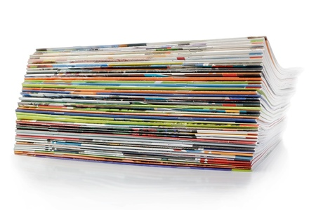A large stack of magazines. On a white background with shadow. photo