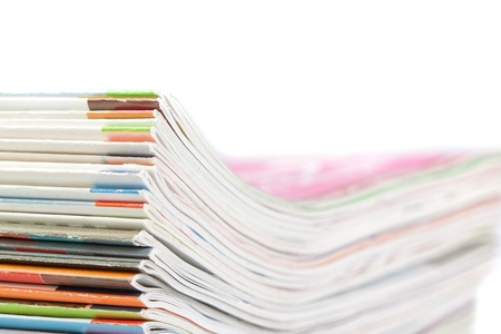 A stack of magazines on a white background. Close-up. photo