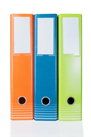 Three colored folders for office clerical. On a white background. photo