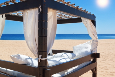Lounger bed, on the beach for a relaxing getaway. photo