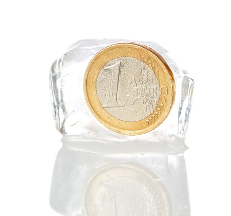 Financial crisis in Europe, inflation, the euro. Euro frozen on a white background. photo
