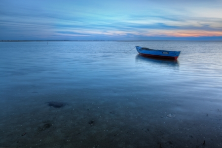 boat accident: Old abandoned boat on the sea in the background of a sea landscape. Stock Photo