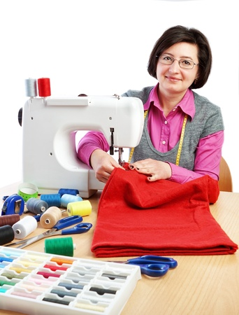 Woman worker sews on the sewing machine  Stock Photo