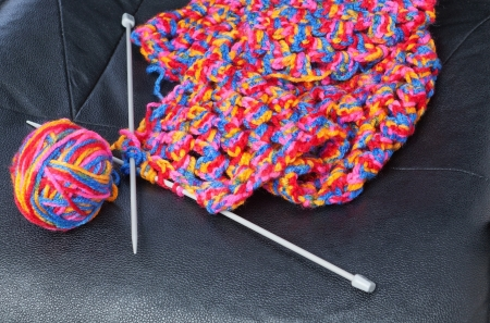 needlecraft product: Product for knitting of colored threads on a leather chair