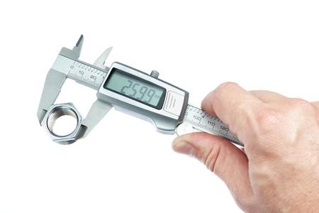 A man measures the piece caliper. Close-up. photo