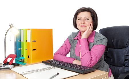 office supplies: Middle-aged woman secretary at the desk.