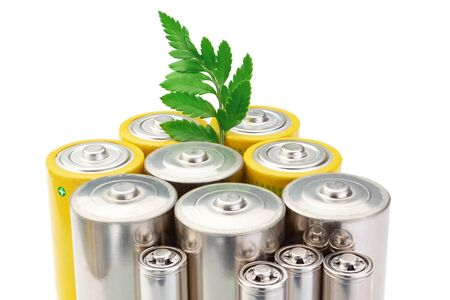 Alkaline batteries symbol of clean energy and green leaf on a white background. photo