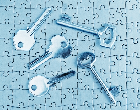 Different types of keys on the puzzle close-up in cold tones. photo