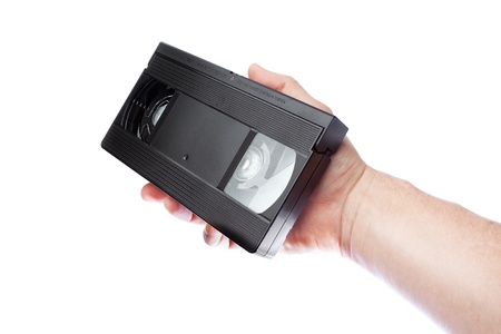 vhs videotape: In the hand of a man old videotape format VHS. Stock Photo