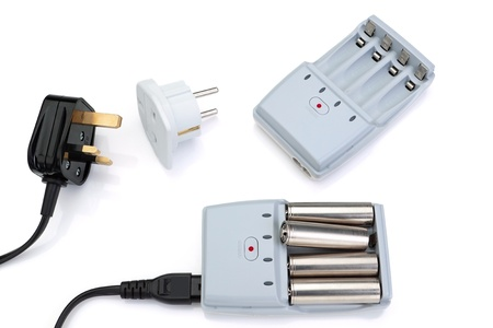 Plug adapter, charger and battery. On a white background. photo
