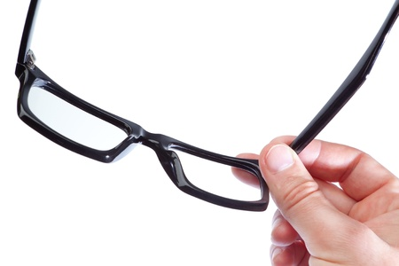 opthalmology: Glasses in the hand of a man on a white background. Close-up.