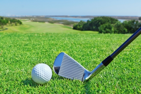 Golf accessories on a background of a green golf course.