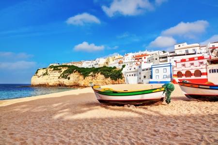 coastline: Portuguese beach villa in Carvoeiro classic fishing boats. Summer. Stock Photo