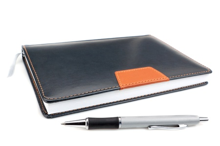 Notebook office organizer and Funky ballpoint pen. On a white background. photo