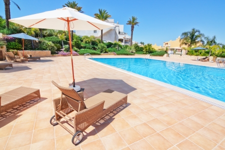 Lovely pool for holidays and umbrella sun beds.Portugal Algarve. Quinta de boa Nova. photo