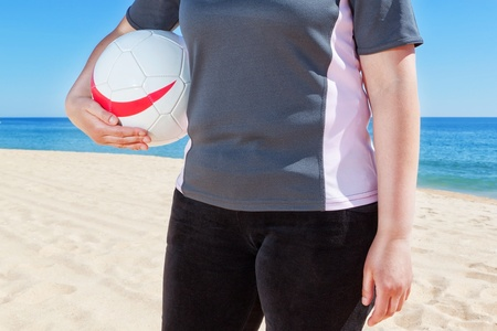 Middle-aged woman playing volleyball at the beach. Summer. Stock Photo - 20591161