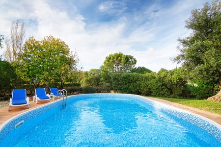 Luxury summer swimming pool with sun loungers. For relaxation and swimming. Summer. photo