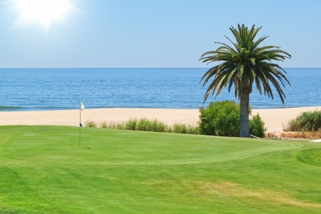 pacific ocean: Beautiful view of the golf course to the sea and palm trees  Portugal, Algarve  Stock Photo