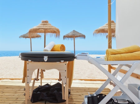 Massage area and a deck chair on the beach for therapy  Near the sea  Standard-Bild
