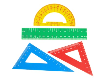 triangle objects: School tools triangle, ruler, protractor. Close-up.