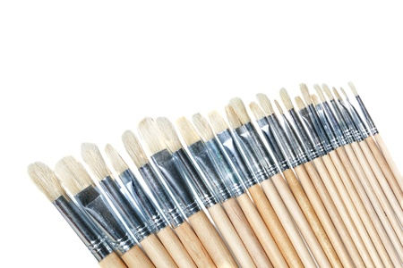 A set of brushes for painting in a row of artists. On a white background. photo