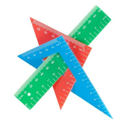 School tools multicolored triangle, ruler, protractor. Close-up. photo