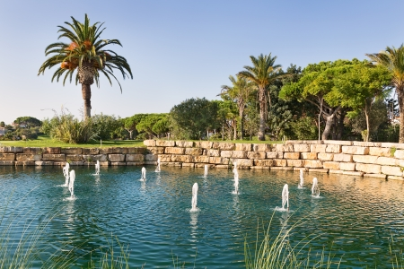 Luxury Fountain Lake in the park golf course in Portugal Stock Photo - 23116262