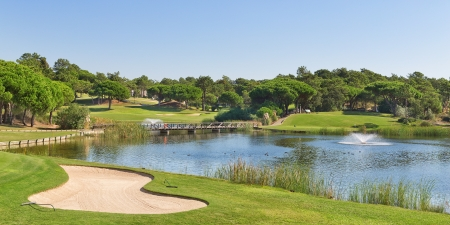 of course: Sports golf park in Portugal. Near lake and fountain. Stock Photo