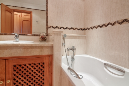 Bathroom with bath in a luxury hotel. photo