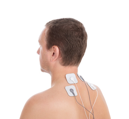 Man in profile makes electrostimulator massage for the neck. photo