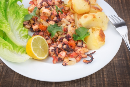 delicacy: Delicacy dish of grilled octopus, marine products. Stock Photo