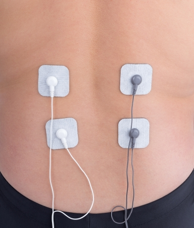 Electrostimulator of massager lumbar spine. For procedures. photo