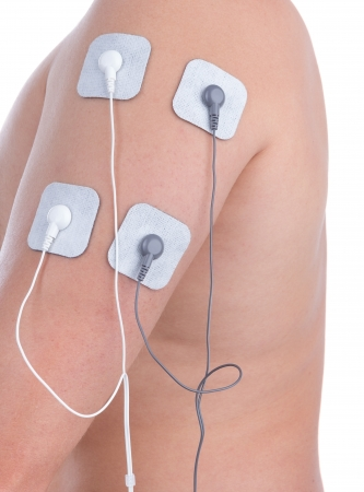 Electrostimulator of massager on shoulder biceps. For procedures and relaxation. photo