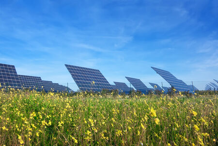 Station solar panels on a beautiful green lawn. For the generation of electricity. photo
