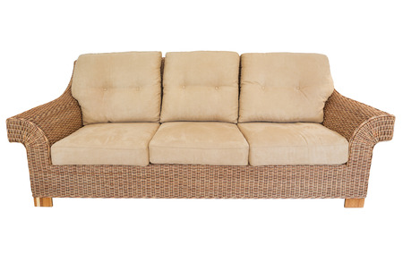 cane sofa: Modern straw sofa in retro style. On a white background. Stock Photo