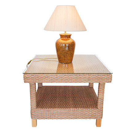 Straw table and lamp shades to decorate rooms. On the glass.