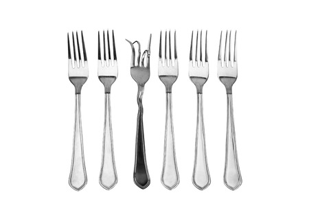The concept of a set forks on nutrition and diet. On a white background. photo