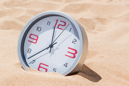 Concept time deadline. Hours on the beach. photo